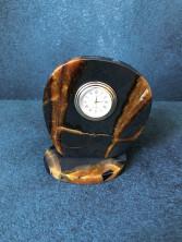 Часы на срезе камня Симбирцит