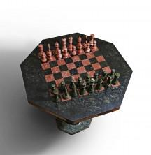 Шахматы и шахматный стол из камней.